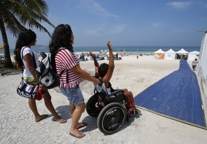 Boy in wheelchair with carer, Mallorca